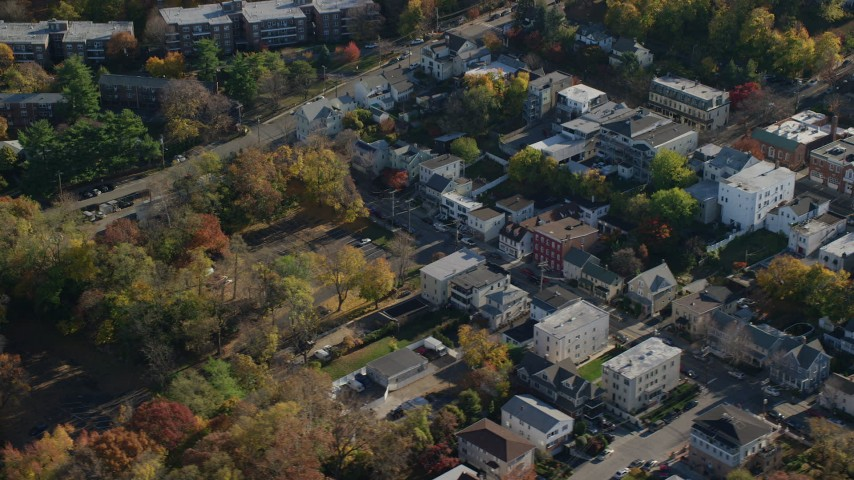 6K stock footage aerial video of an orbit of small town shops in Dobbs Ferry in Autumn, New York Aerial Stock Footage | AX119_081