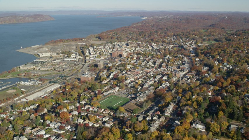 6K stock footage aerial video of riverfront town of Sleepy Hollow in Autumn, New York Aerial Stock Footage | AX119_088