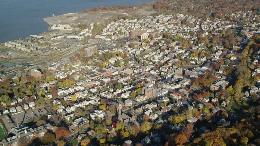 6K stock footage aerial video orbit riverfront town of Sleepy Hollow in Autumn, New York Aerial Stock Footage | AX119_089