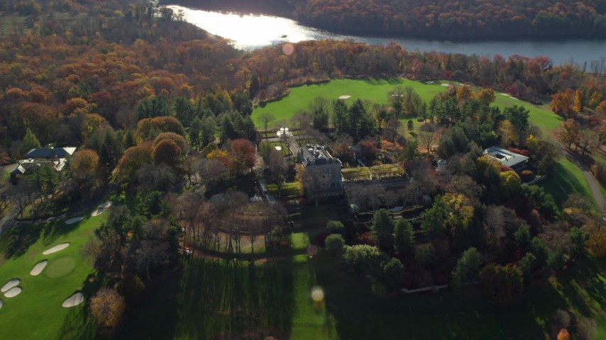 6K stock footage aerial video of circling the historic Kykuit Estate in Autumn, Westchester County, New York Aerial Stock Footage | AX119_095