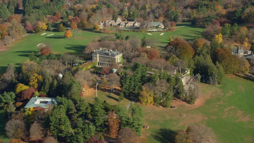 6K stock footage aerial video of circling around the historic Kykuit Estate in Autumn, Westchester County, New York Aerial Stock Footage | AX119_096