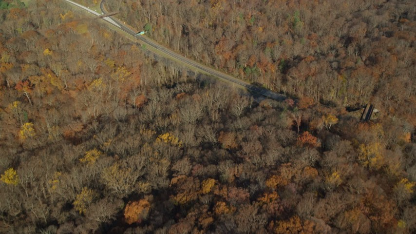 6K stock footage aerial video fly over forest in Autumn, Sleepy Hollow, New York Aerial Stock Footage | AX119_099