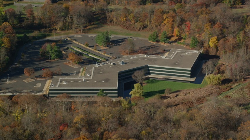 6K stock footage aerial video of orbiting an isolated office building in Autumn, Sleepy Hollow, New York Aerial Stock Footage AX119_101 | Axiom Images