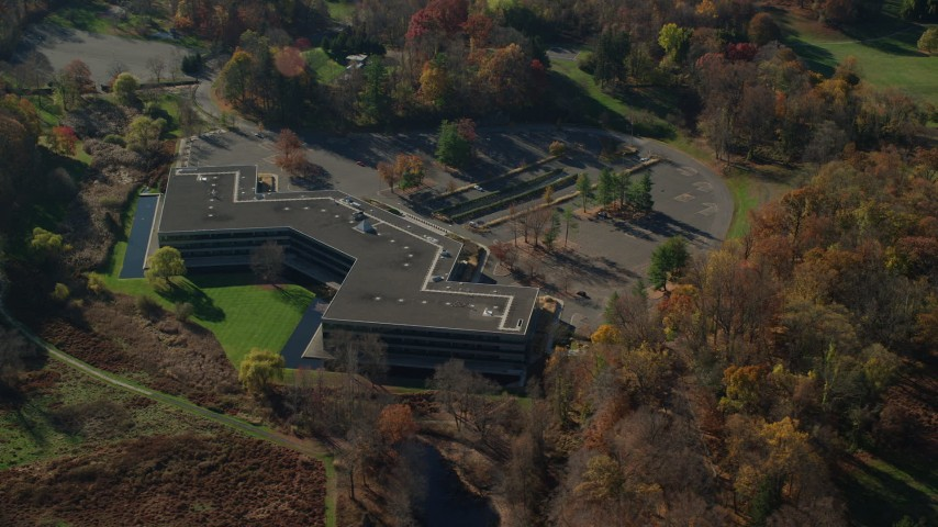 6K stock footage aerial video of circling an isolated office building in Autumn, Sleepy Hollow, New York Aerial Stock Footage | AX119_103