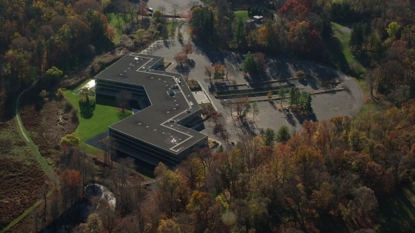 6K stock footage aerial video of an orbit of an isolated office building in Autumn, Sleepy Hollow, New York Aerial Stock Footage | AX119_104