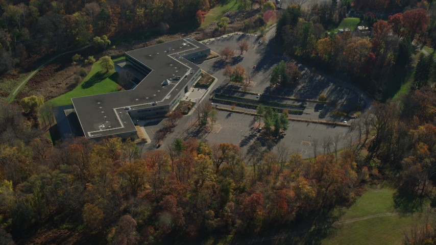 6K stock footage aerial video of an isolated office building in Autumn, Sleepy Hollow, New York Aerial Stock Footage | AX119_105