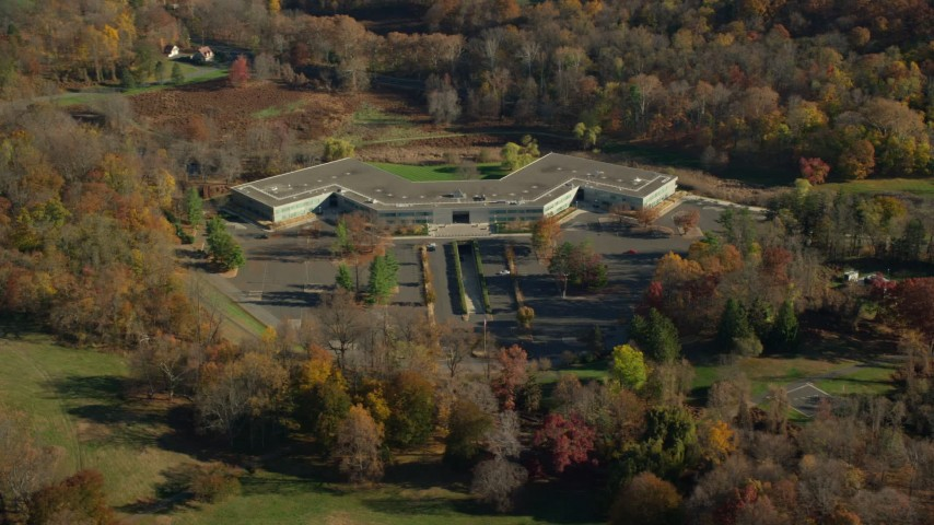 6K stock footage aerial video of circling around an office building in Autumn, Sleepy Hollow, New York Aerial Stock Footage | AX119_106