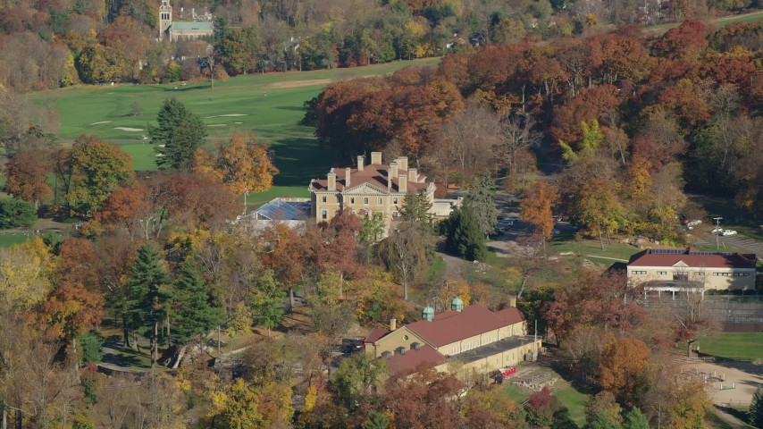 6K stock footage aerial video of a historical mansion at country club in Autumn, Briarcliff Manor, New York Aerial Stock Footage | AX119_108
