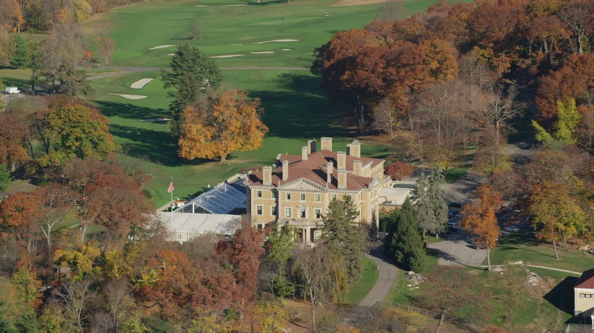 6K stock footage aerial video of a historical mansion and country club in Autumn, Briarcliff Manor, New York Aerial Stock Footage | AX119_109