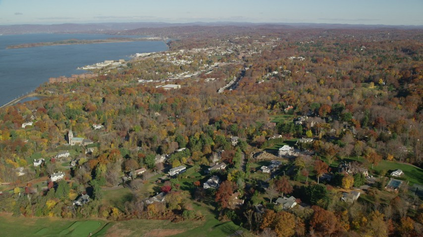 6K stock footage aerial video of a small riverfront town in Autumn, Briarcliff Manor and Ossining, New York Aerial Stock Footage AX119_111 | Axiom Images