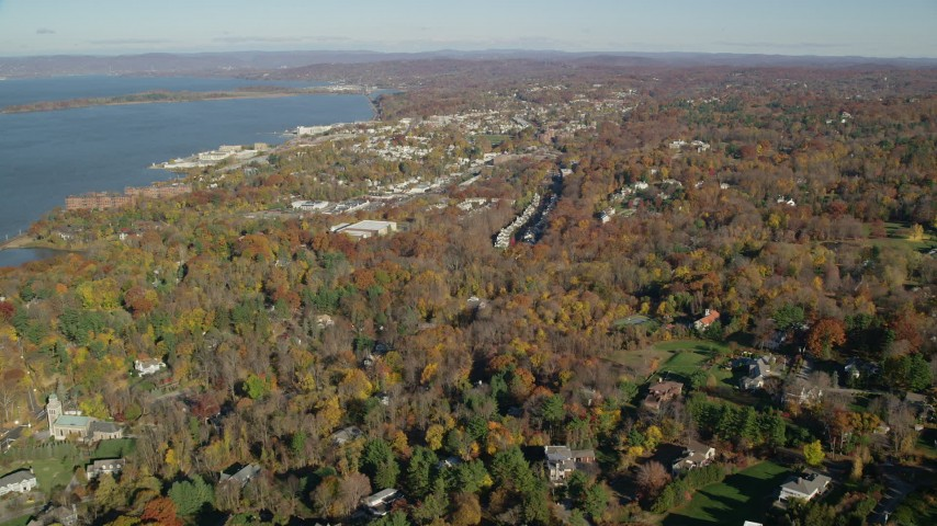 6K stock footage aerial video of a small riverfront town in Autumn, Briarcliff Manor and Ossining, New York Aerial Stock Footage | AX119_112