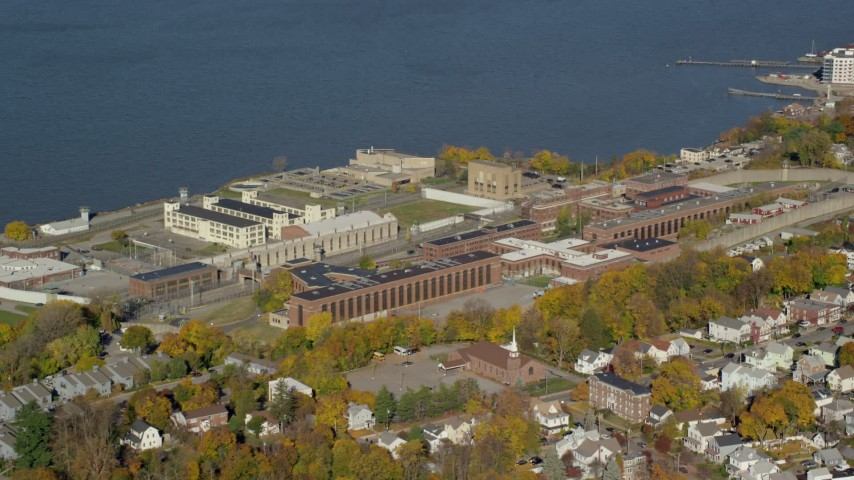 6K stock footage aerial video of Sing Sing Prison in Autumn, Ossining, New York Aerial Stock Footage | AX119_113
