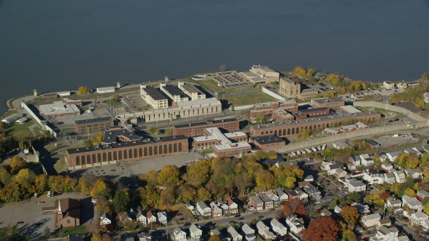 6K stock footage aerial video of orbiting Sing Sing Prison in Autumn, Ossining, New York Aerial Stock Footage | AX119_114