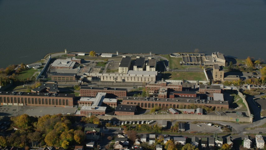 6K stock footage aerial video of orbiting the buildings of Sing Sing Prison in Autumn, Ossining, New York Aerial Stock Footage | AX119_115