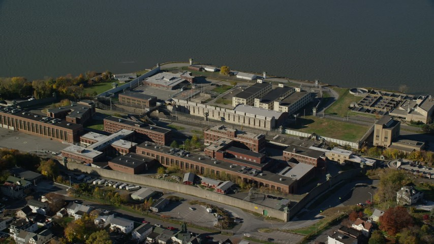 6K stock footage aerial video of an orbit of Sing Sing Prison in Autumn, Ossining, New York Aerial Stock Footage | AX119_116