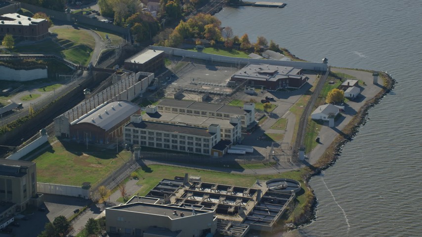 6K stock footage aerial video of an orbit of buildings at Sing Sing Prison in Autumn, Ossining, New York Aerial Stock Footage AX119_119 | Axiom Images