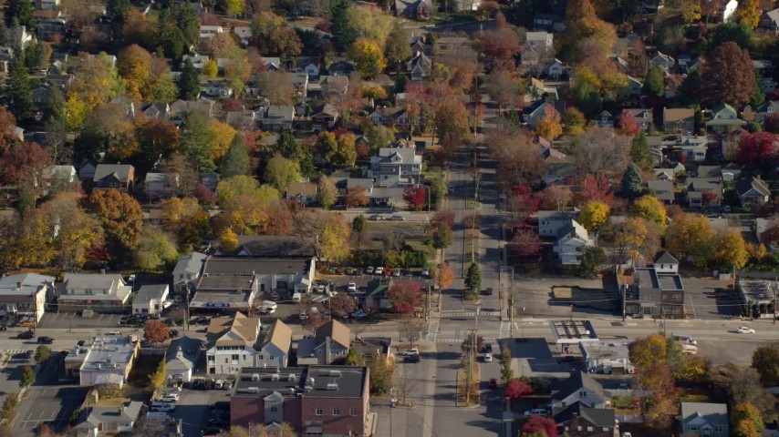 6K stock footage aerial video of homes near a small town street intersection in Autumn, Croton on Hudson, New York Aerial Stock Footage | AX119_130