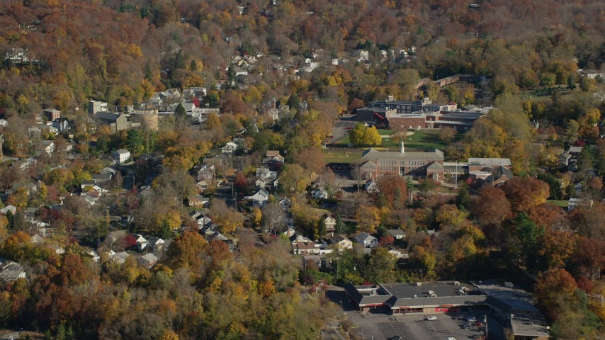 6K stock footage aerial video of homes near near high and middle schools in Autumn, Croton on Hudson, New York Aerial Stock Footage | AX119_131
