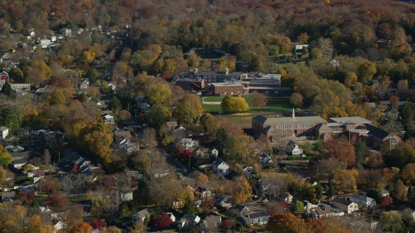 6K stock footage aerial video of an orbit of homes near near high and middle schools in Autumn, Croton on Hudson, New York Aerial Stock Footage | AX119_132