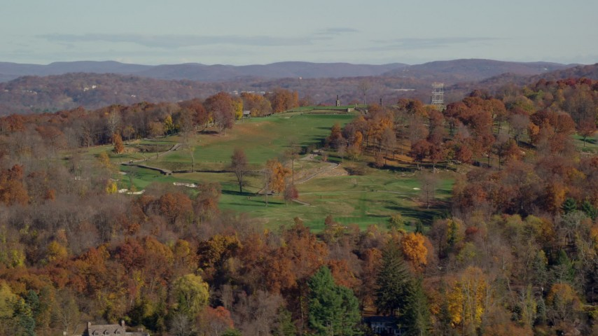 6K stock footage aerial video of a hillside golf course in Autumn, Croton on Hudson, New York Aerial Stock Footage | AX119_133