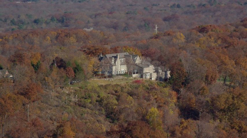 6K stock footage aerial video orbit an isolated hilltop mansion in Autumn, Croton on Hudson, New York Aerial Stock Footage | AX119_134
