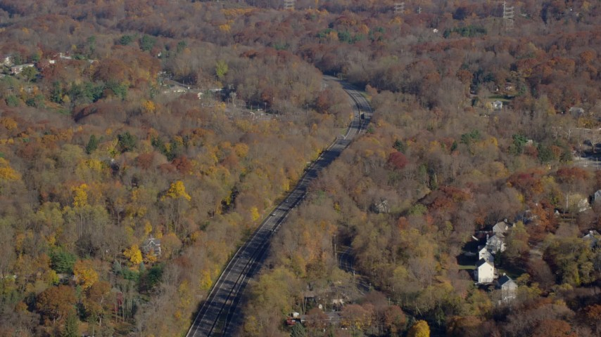 6K stock footage aerial video of a tree-lined highway in Autumn, Croton on Hudson, New York Aerial Stock Footage | AX119_135