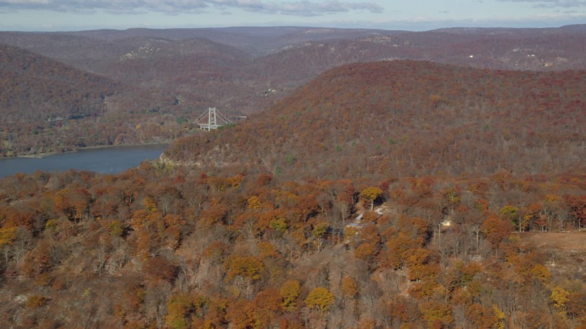 6K stock footage aerial video of forest in Autumn by the Hudson River, Westchester County, New York Aerial Stock Footage | AX119_149