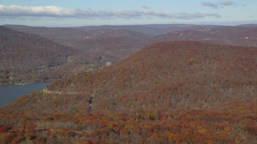 6K stock footage aerial video of flying by forest in Autumn by the Hudson River, Westchester County, New York Aerial Stock Footage | AX119_150