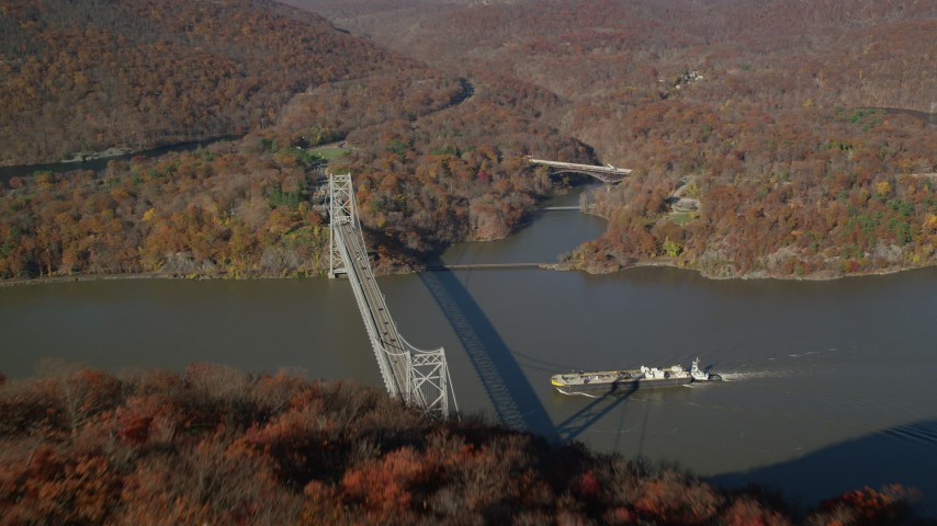 6K stock footage aerial video fly over forest to reveal Bear Mountain Bridge in Autumn, Westchester County, New York Aerial Stock Footage AX119_153 | Axiom Images