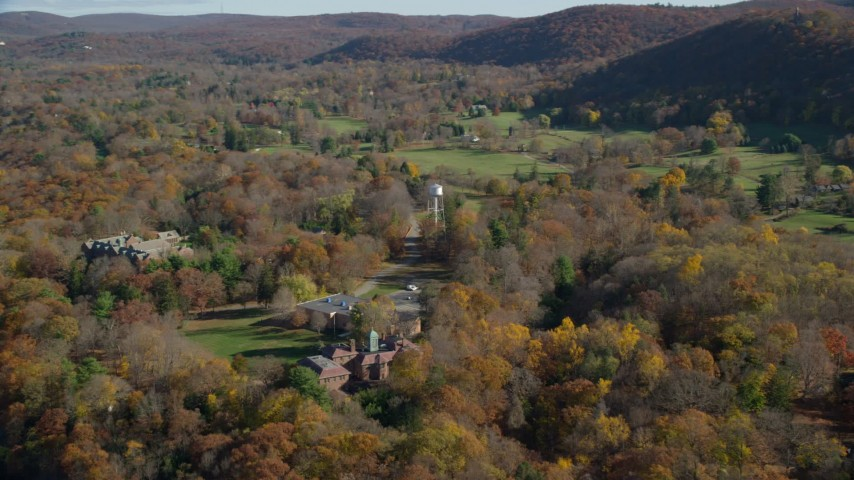 6K stock footage aerial video of water tower and mansion in Autumn, Garrison, New York Aerial Stock Footage | AX119_162