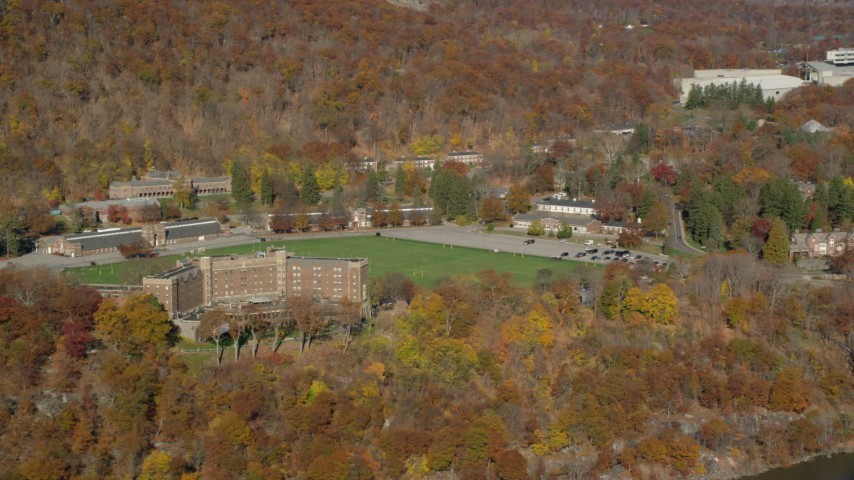6K stock footage aerial video of Thayer Hotel in Autumn, West Point, New York Aerial Stock Footage | AX119_163