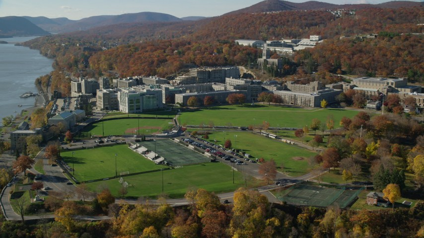 6K stock footage aerial video of circling West Point Military Academy in Autumn, West Point, New York Aerial Stock Footage | AX119_169