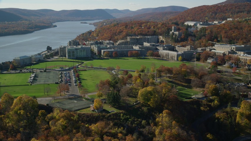 6K stock footage aerial video of orbiting around West Point Military Academy in Autumn, West Point, New York Aerial Stock Footage | AX119_170
