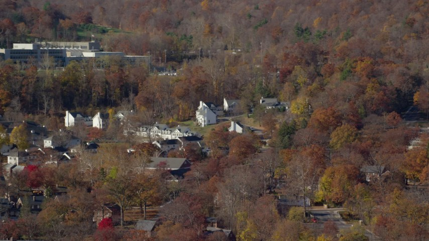 6K stock footage aerial video of housing at West Point Military Academy in Autumn, West Point, New York Aerial Stock Footage | AX119_171