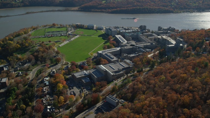 6K stock footage aerial video of an orbit around West Point Military Academy in Autumn, West Point, New York Aerial Stock Footage | AX119_175
