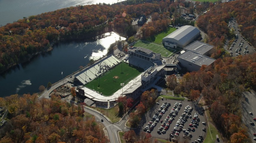 6K stock footage aerial video of Michie Stadium at West Point Military Academy in Autumn, West Point, New York Aerial Stock Footage | AX119_176