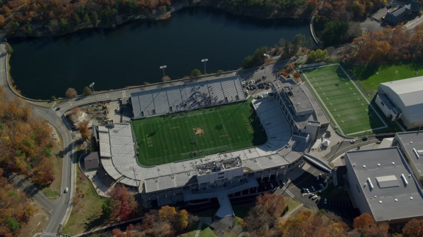 5.5K stock footage aerial video of Michie Stadium at West Point Military Academy in Autumn, West Point, New York Aerial Stock Footage | AX119_176E