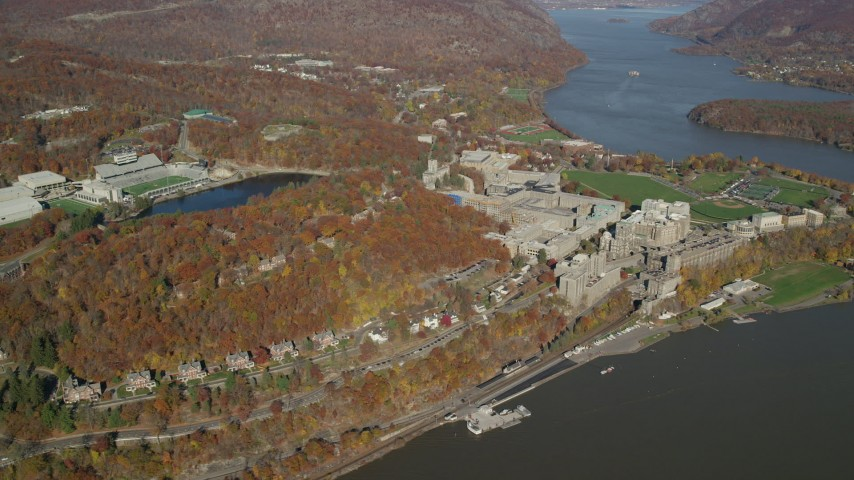 6K stock footage aerial video of a wide orbit around West Point Military Academy in Autumn, West Point, New York Aerial Stock Footage | AX119_180