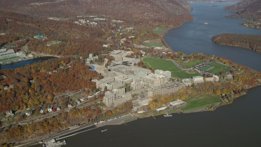 6K stock footage aerial video of flying by West Point Military Academy in Autumn, West Point, New York Aerial Stock Footage | AX119_181