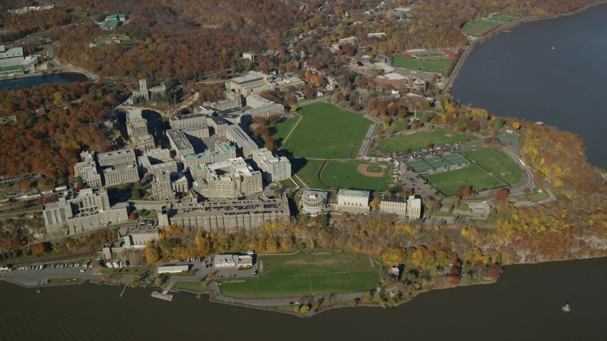 6K stock footage aerial video wide orbit around West Point Military Academy in Autumn, West Point, New York Aerial Stock Footage | AX119_183