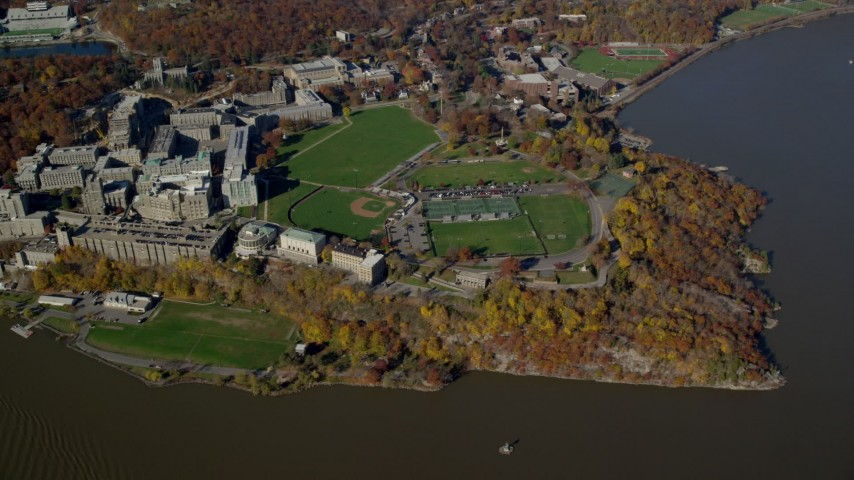 6K stock footage aerial video of flying away from West Point Military Academy in Autumn, West Point, New York Aerial Stock Footage | AX119_184