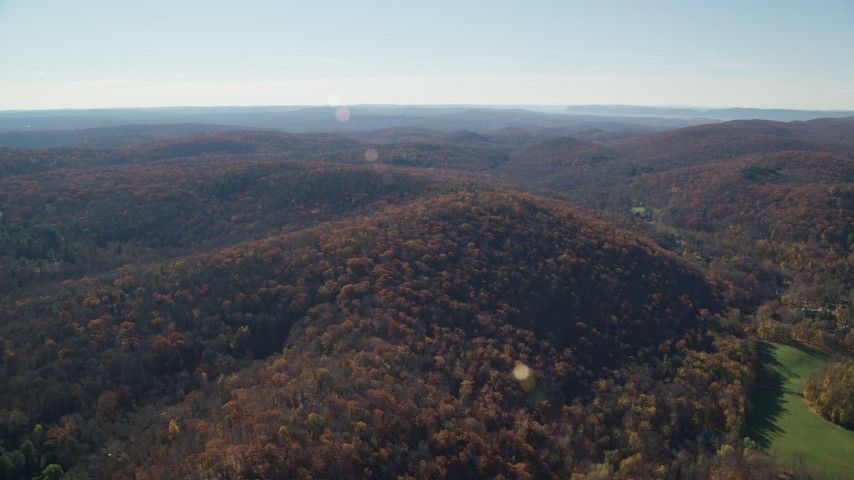 6K stock footage aerial video approaching hills with forests in Autumn, Garrison, New York Aerial Stock Footage | AX119_185
