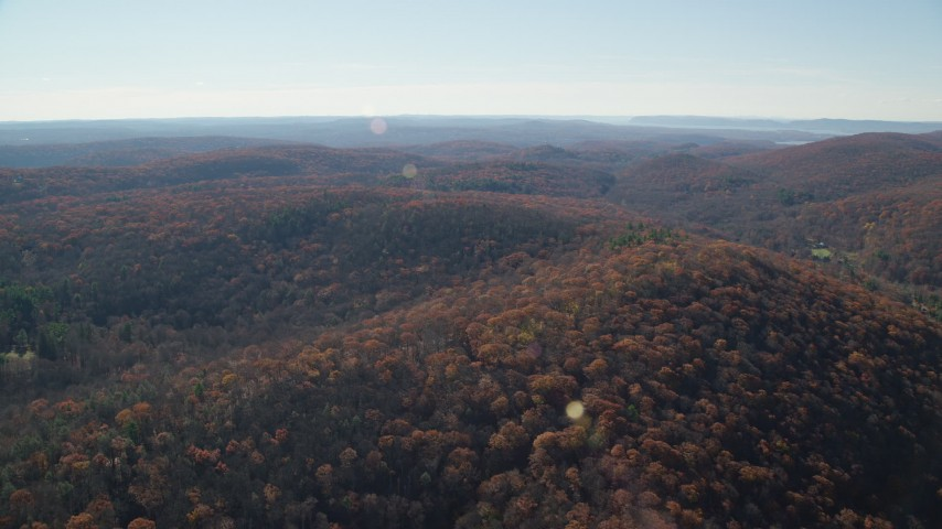 6K stock footage aerial video fly over hills with forests in Autumn, Garrison, New York Aerial Stock Footage | AX119_186