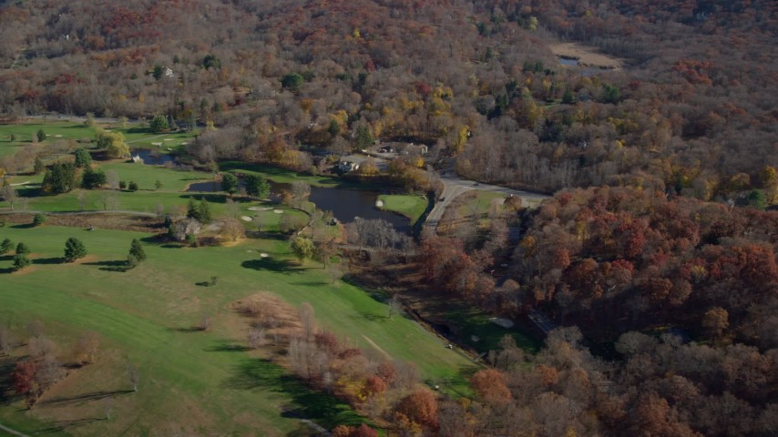 6K stock footage aerial video of a golf course in Autumn, Garrison, New York Aerial Stock Footage | AX119_187