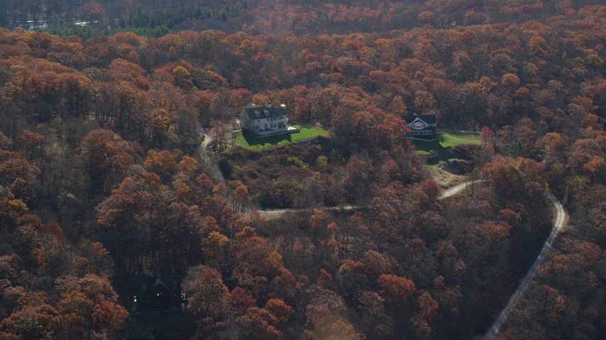 6K stock footage aerial video of hilltop homes in Autumn, Garrison, New York Aerial Stock Footage | AX119_188