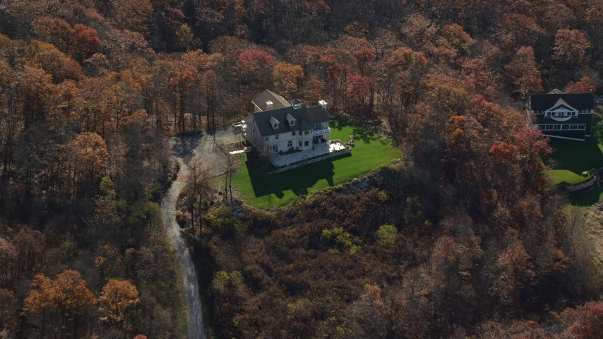 6K stock footage aerial video of flying over a hilltop home in Autumn, Garrison, New York Aerial Stock Footage | AX119_189