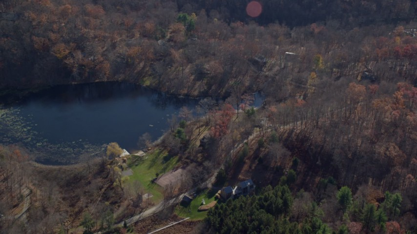 6K stock footage aerial video of lakeside homes in Autumn, Garrison, New York Aerial Stock Footage | AX119_190