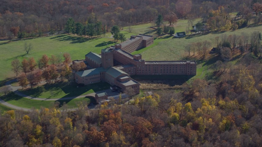 6K aerial stock footage video of a secluded hospital in Autumn, Mohegan Lake, New York Aerial Stock Footage | AX119_198