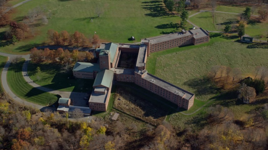 6K stock footage aerial video orbit a secluded hospital in Autumn, Mohegan Lake, New York Aerial Stock Footage AX119_199 | Axiom Images