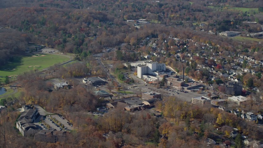 6K stock footage aerial video orbit a small town hospital in Autumn, Mt Kisco, New York Aerial Stock Footage | AX119_212